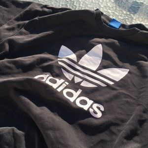 This is a black long sleeve adidas sweater